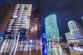 BERLIN, GERMANY - SEPTEMBER 20, 2013:  cityscape at Potsdamer Platz financial district. The district is a major site of commercial development with a long history as the heart of the city.