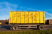 Truck trailer with a yellow cargo container