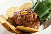 Beef Tartare with Quail Eggs Yolk and Thyme Biscuits