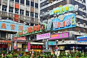 HONG KONG - OCTOBER 8, 2012: Overhead advertisements in the Tsim Sha Tsui district of Kowloon. The d