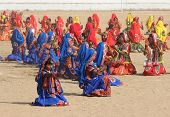 PUSHKAR, INDIA - NOVEMBER 21 2012: Indian girls in colorful ethnic attire dancing at Pushkar camel f