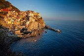 Manarola town of Cinque Terre National Park at sunset, Italy