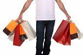 Man holdingshopping bags