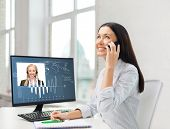 business, communication and technology concept - smiling businesswoman or student with smartphone ta