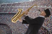 Fervent fans of football team play the saxophone