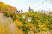 QUEBEC CITY, CANADA, OCTOBER 13, 2013 -  Cable cars in Montmorency Falls Park. The waterfall is 83 m