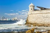 image of el morro castle  - Tower of the castle of El Morro with the Havana skyline clearly visible in the background - JPG