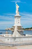 Statue of Neptune in the bay of Havana with the castle of El Morro in the background