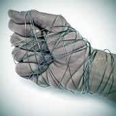 picture of sadistic  - man hand tied with wire - JPG