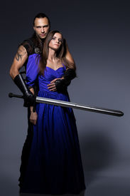 foto of longsword  - Beautiful couple with historical costumes - JPG