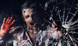 stock photo of ghoul  - Creepy zombie breaks the window - JPG