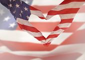 American flag on heart shaped hands