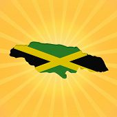 Jamaica map flag on sunburst illustration