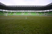 Arena with green tribune. Empty green bleachers at Ferencvaros Budapest  stadium.
