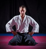 image of aikido  - Aikido fighter on black background - JPG