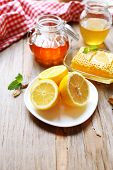 Lemon and honey on wooden table