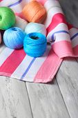 Colorful clews on color napkin background