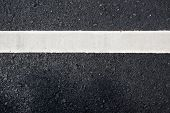 White Paint Line On Asphalt Road