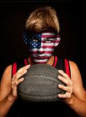 portrait of basketball player with united estates flag painted on his face