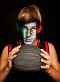 portrait of basketball player with mexican flag painted on his face