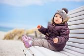 toddler sitting colder times in the norhsea
