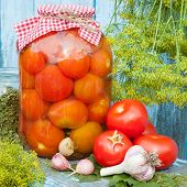 Homemade Canned Tomatoes In Glass Jar. Fresh Vegetables, Dill And Garlic