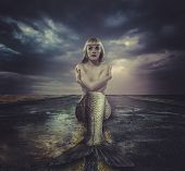 pic of fish skin  - naked mermaid sitting on a deserted road - JPG