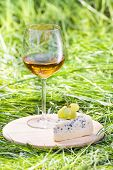 Glass of wine with cheese