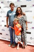BRIDGEHAMPTON, NY-JUL 19: (L-R) Nick Manifold, Lukas Rector and Kelly Klein attend the 6th Annual Fa