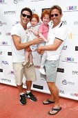 BRIDGEHAMPTON, NY-JUL 19: (L-R) Mark Feuerstein, Lily Rae, Jacob & Eric Feuerstein attend the Family