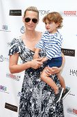 BRIDGEHAMPTON, NY-JUL 19: Actress Molly Sims (L) and son Brooks Stuber attend the 6th Annual Family