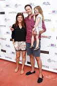 BRIDGEHAMPTON, NY-JUL 19: (L-R) Tiffani Thiessen, Brady Smith & Harper Smith attend the 6th Annual F