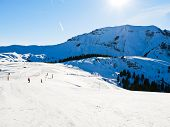 Ski Run On Snow Slopes Of Mountains In Sunny Day