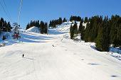Ski Lift And Skiing Tracks On Snow Alps Mountains