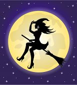 stock photo of moon silhouette  - silhouette of beautiful witch with hat flying on a broomstick on the background of the moon and the sky - JPG