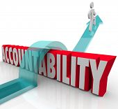 Person jumping over the word Accountability as a worker or someone avoiding or running from responsi