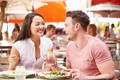 Couple Enjoying Lunch In Outdoor Restaurant
