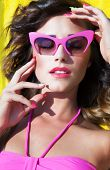 Colorful summer portrait of young attractive brunette woman wearing sunglasses, beauty and fashion c