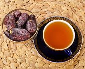Ramadan eastern refreshment drink with dates on table placemat , top view