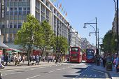 LONDON, UK - JUNE 3, 2014: Regent street busy junction with lots of people and public transport