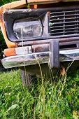 Abandoned rusted car closeup