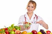 stock photo of recommendation  - Doctor dietitian recommending healthy food - JPG
