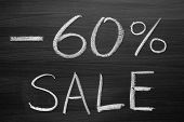 60-percent sale title written with a chalk on the blackboard