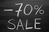 70-percent sale title written with a chalk on the blackboard