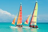 CAYO SANTA MARIA, CUBA - JULY 15, 2014 : Tourists sailing in colorful catamarans on a beautiful sunn
