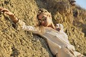 attractive woman who is lying on the rocks