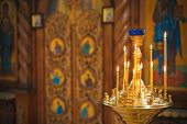 picture of church interior  - Burning candles in a Russian ortodox church. Close-up of ordinary church interior. Selective focus. ** Note: Soft Focus at 100%, best at smaller sizes - JPG