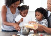 Ethnic Family Making Biscuits Together