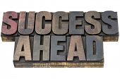 success ahead - isolated words in vintage letterpress wood type with ink patina
