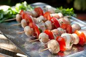 Raw Chicken Kebabs With Onion, Tomatoes And Champignon